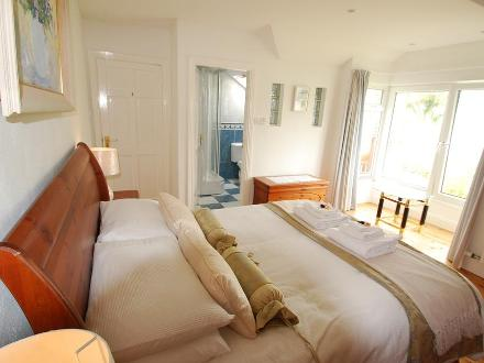 Master bedroom with 5' bed and en suite shower room with sea view.