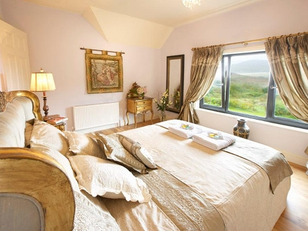First floor: Double bedroom with views over the garden to the sea.